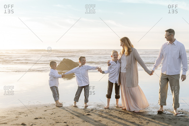 Portrait of family holding hands on bright sky