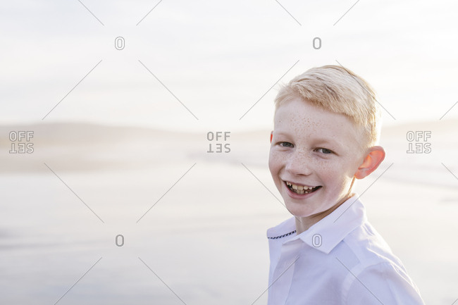 Portrait of a blond boy at the beach