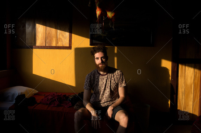 Man sitting in a room in morning light