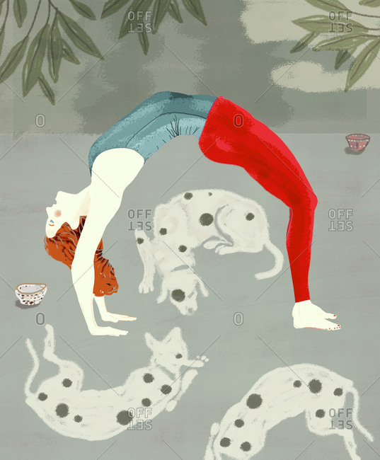 Women doing yoga with her dogs