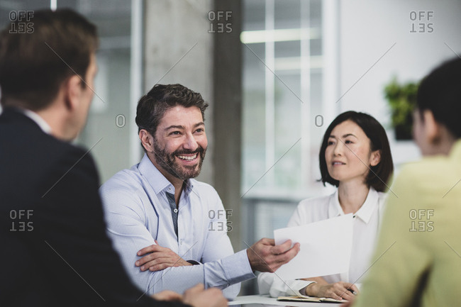 Corporate business executives celebrating success in a meeting