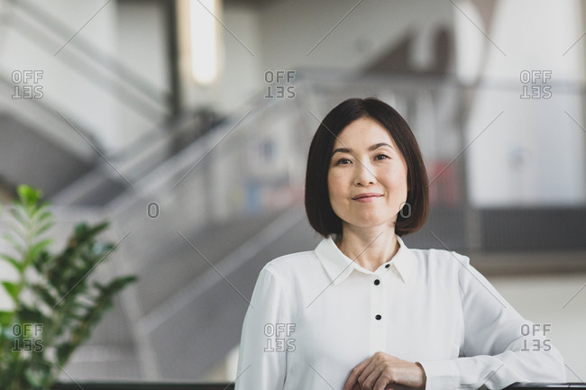 Portrait of Japanese businesswoman in corporate office