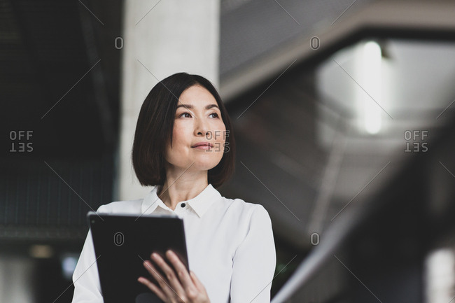 Japanese businesswoman using digital tablet in a corporate office