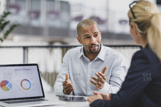 African American businessman leading a corporate meeting
