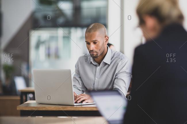 Businessman in a caf̩ using a laptop