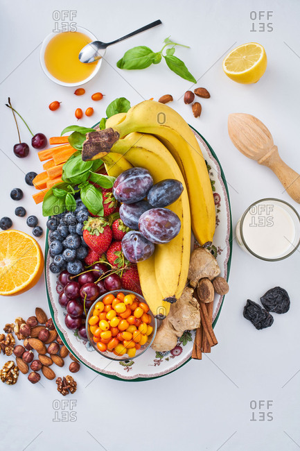 Colorful fruits, veggies and nuts in a dish