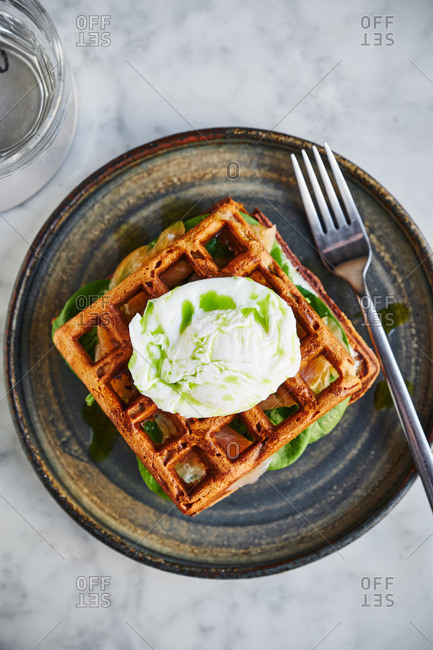 Overhead view of eggs Florentine served on waffles