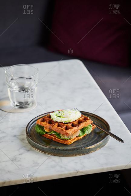 Eggs Florentine on waffles