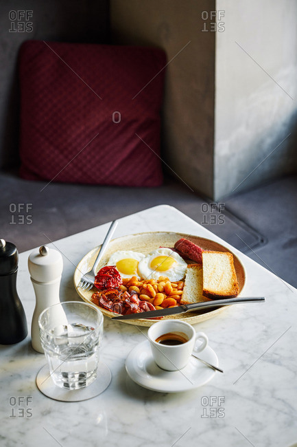 A full English breakfast served on a marble table