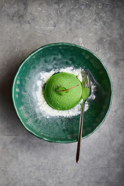 Green gourmet dessert in the form of a hemisphere