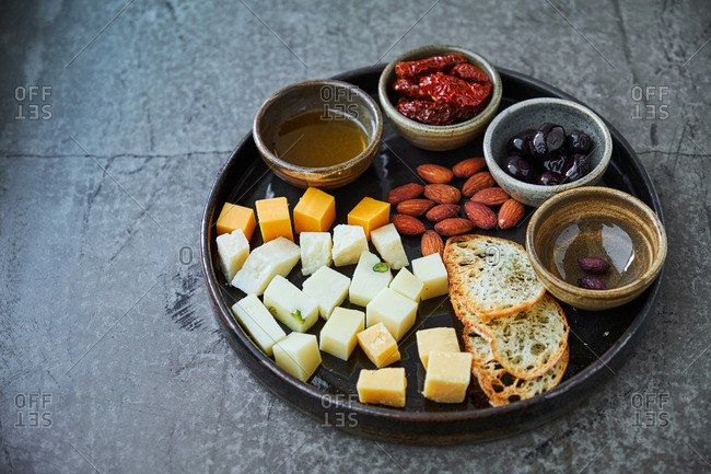 Red wine appetizer platter with cheese and nuts