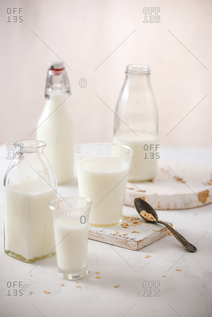 fresh milk in glass jar and glass on wooden background