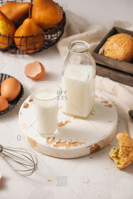 Bottle of milk, eggs, and bread on the wooden table. with copy space for text.