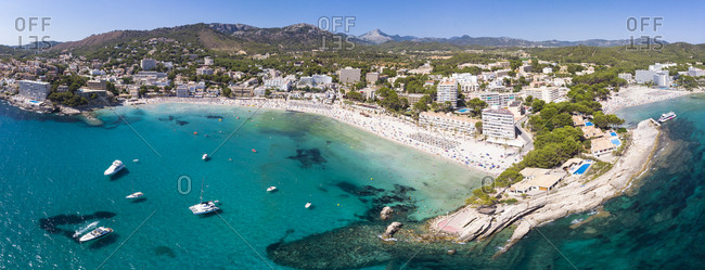 Spain- Balearic Islands- Mallorca- Region Calvia- Costa de la Calma- Peguera- Aerial view of beach with hotels- panorama