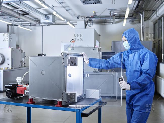 Chemist working in industrial laboratory clean room