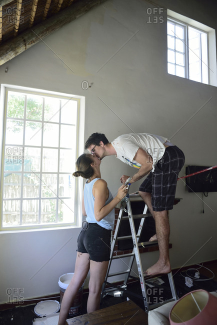 Young couple kissing during renovating their home