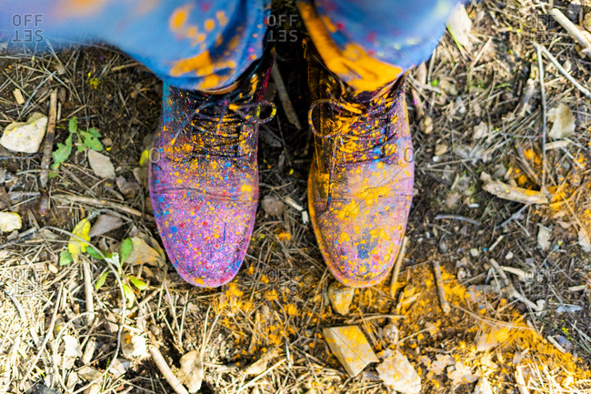 Shoes of a person covered in powder paint- celebrating Holi- Festival of colors