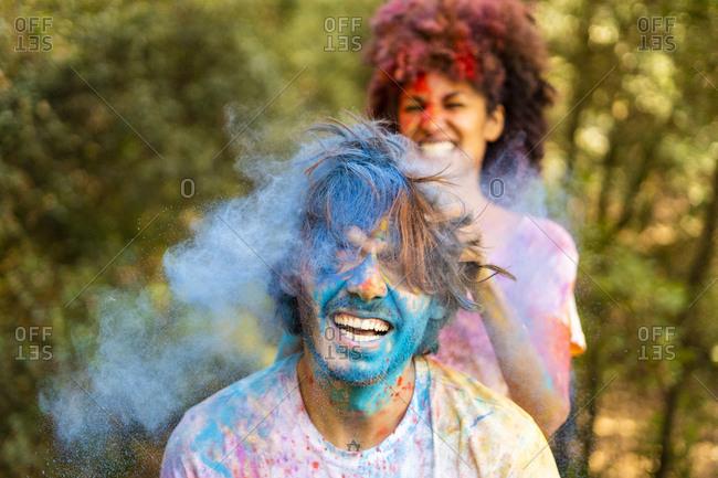 Happy couple celebrating Holi- Festival of Colors