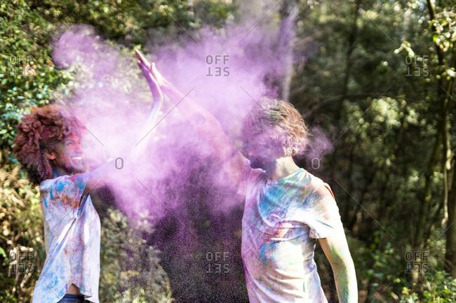 Happy couple celebrating Holi festival. Festival of colors