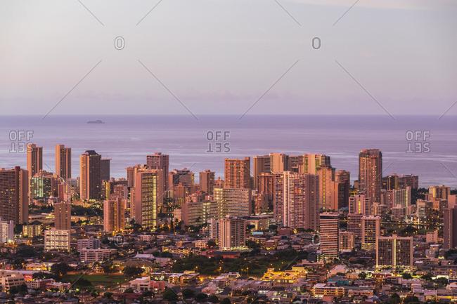 USA- Hawaii - September 25, 2018: Oahu- Pacific Ocean- Skyline of Honolulu- red sky