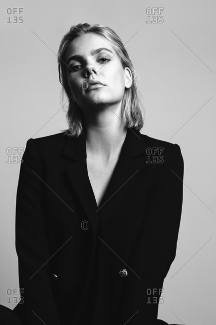 Portrait of blond young woman wearing black blazer