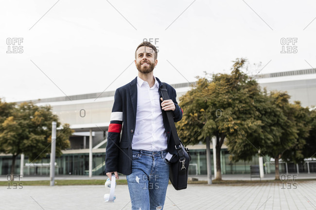 Stylish businessman walking in the city