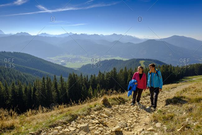 Germany- Bavaria- Hoernle near Bad Kohlgrub- young couple on a hiking trip in alpine landscape