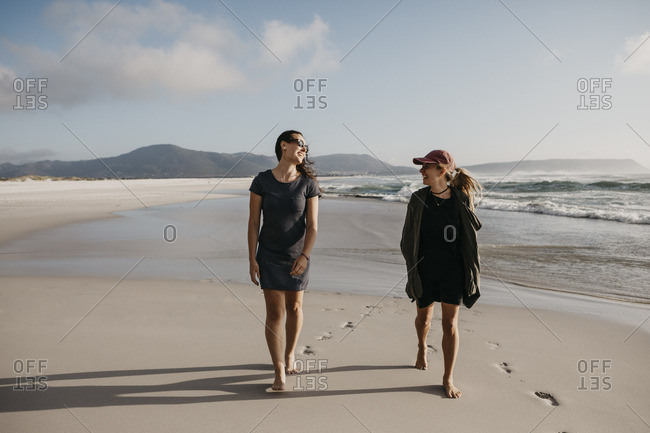 South Africa- Western Cape- Noordhoek Beach- two young women strolling on the beach