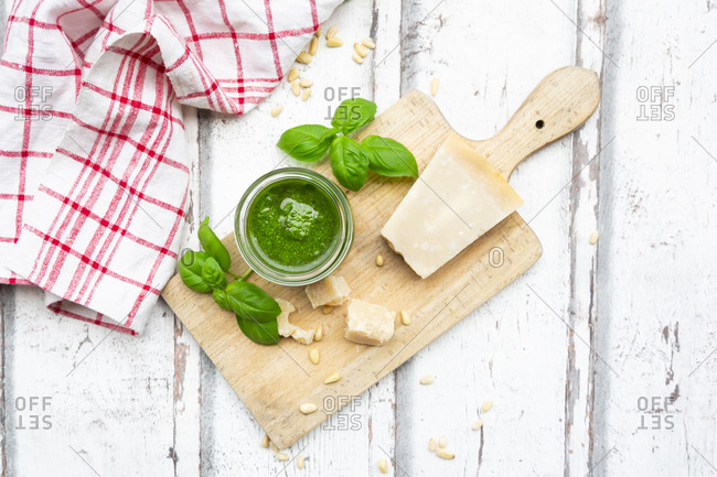 Glass of homemade pesto Genovese- ingredients and kitchen towel