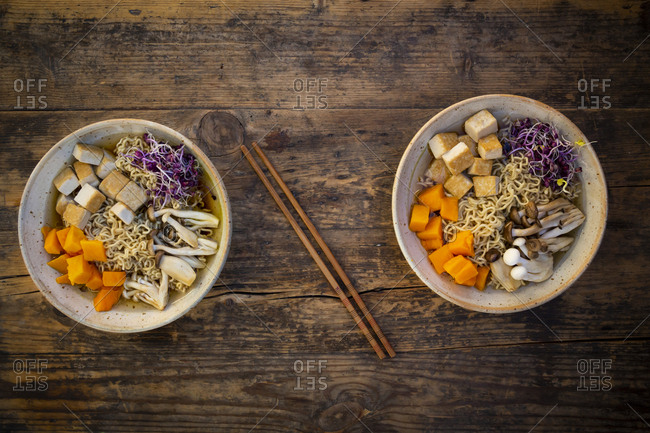 Miso Ramen soup with noodles- red radish sprouts- pumpkin- fried tofu- shimeji and king trumpet mushroom
