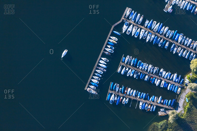 Germany- Bavaria- Chiemgau- Aerial view of Lake Chiemsee- harbor with pleasure crafts
