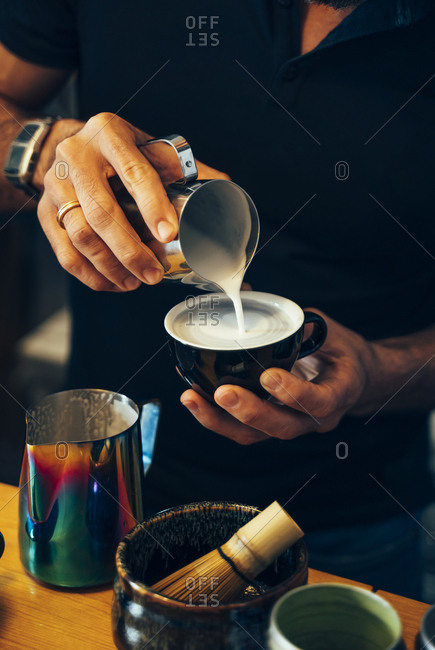Close-up of barista preparing tea in a cafe