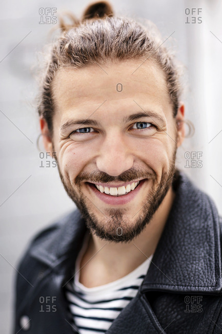 Portrait of a young man with a man bun