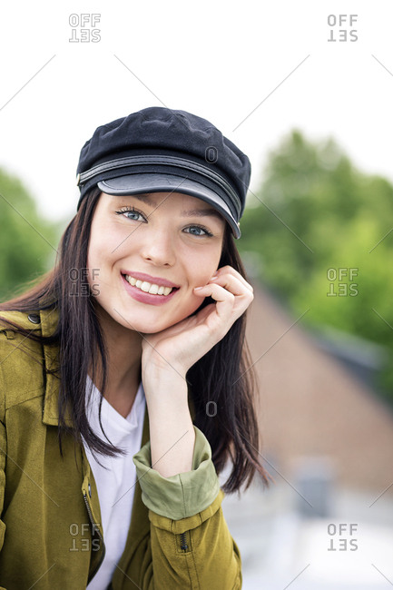 Portrait of a young woman with cap- smiling