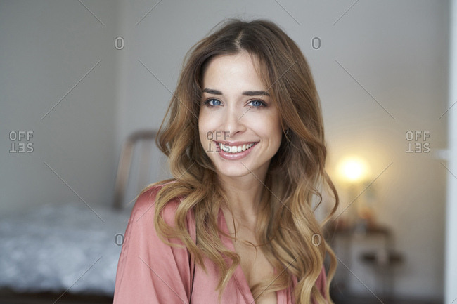 Portrait of smiling young woman wearing dressing gown