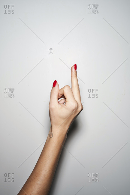 Close-up of woman giving the finger