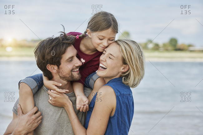 Germany- Duesseldorf- happy family with daughter at Rhine riverbank