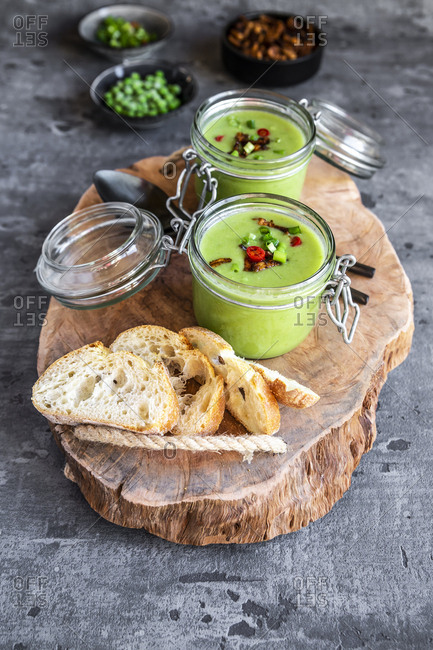 Two glasses of pea soup with fried tofu- red chili pepper and spring onions