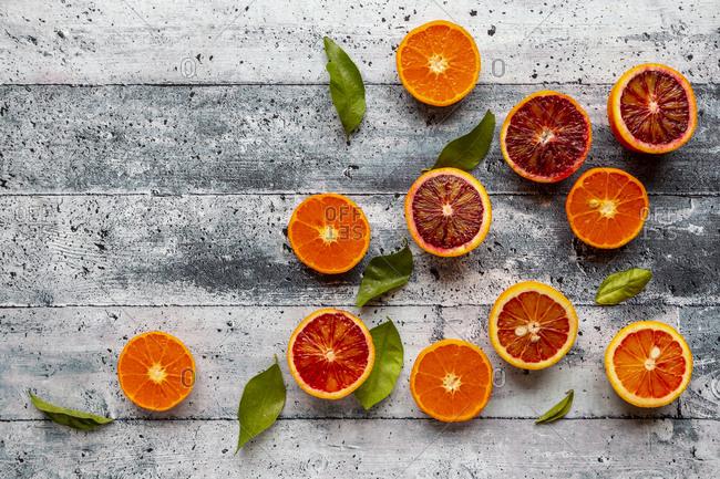 Halves of blood oranges- tangerines and leaves