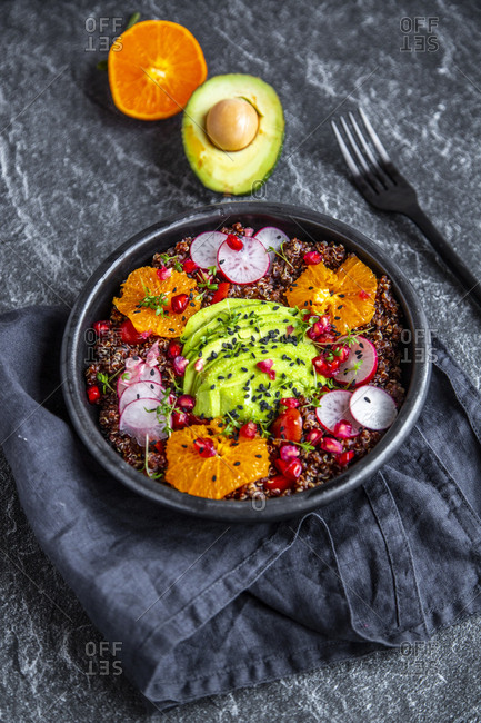 Red Quinoa salad with avocado- tomatoes- red radishes- pomegranate seeds- black sesame and cress