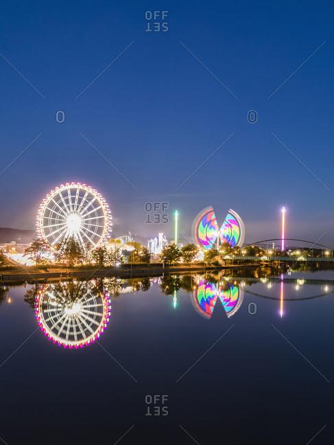 Germany- Stuttgart- Bad Cannstatt- fairground rides at Cannstatter Wasen at iver Neckar
