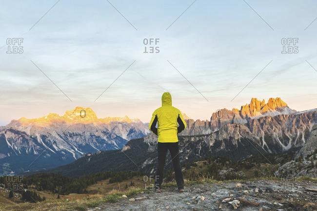 Italy- Tre Cime di Lavaredo- man enjoying colorful mountain peaks at sunset