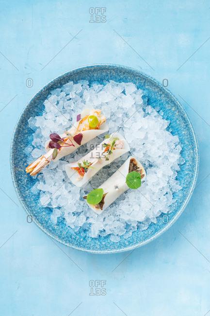 Seafood sushi dish on ice