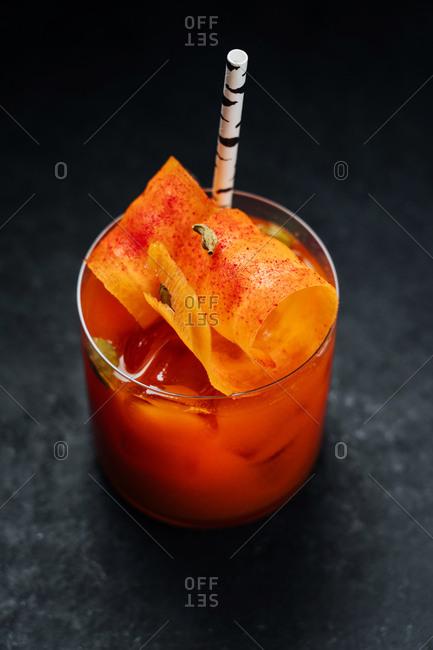 Orange cocktail on ice