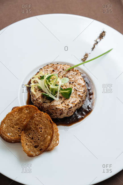 Overhead view of a seared tartare dish