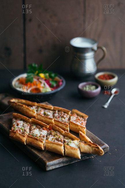 Traditional Turkish pide with salad, ayran and spice