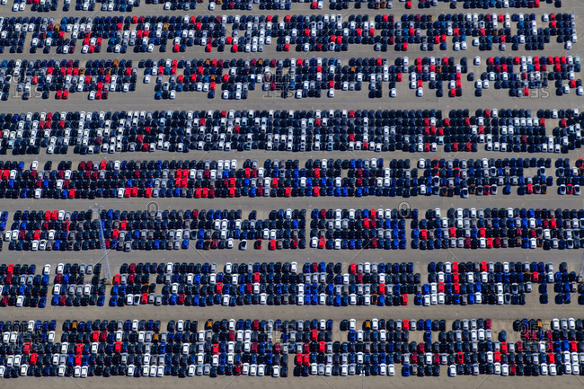 Aerial view of tons of cars in a parking lot