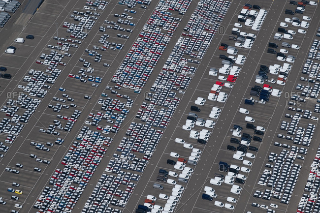Aerial view of tons of vans in a parking lot