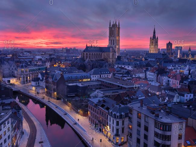 Ghent, Belgium - December 27, 2018: Beautiful sunset over buildings in Belgium