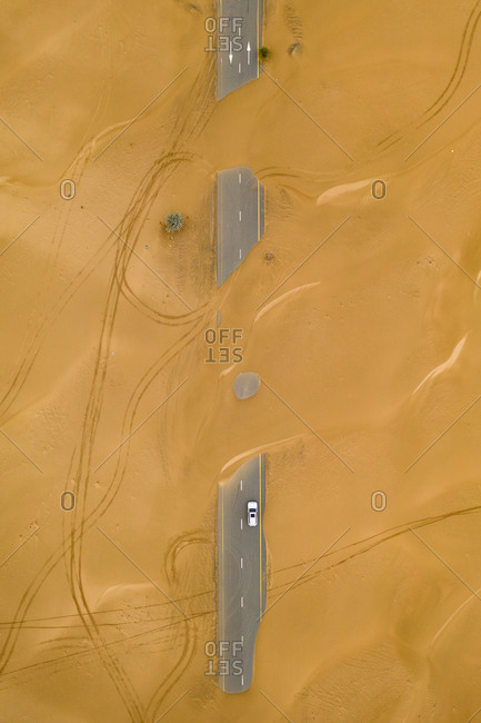 Wind blown sand covering highways in the desert